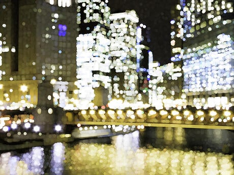 Multicolored abstract of bright city lights with river reflections at night